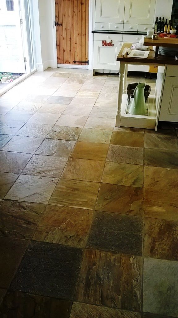 This slate floor was installed in the kitchen of a house in the town of Burton-on-Trent in Staffordshire. As the name suggests, Burton-on-Trent sits alongside the River Trent, which runs through most of the northern Midlands. The old sealer on my client's Slate tiled kitchen floor had completely worn off and, as a result, dirt had become ingrained in the pores of the stone which was now in need of restoration.