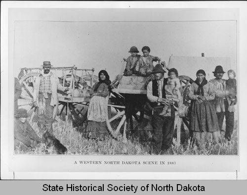 Metis family with Red River carts :: State Historical Society of North Dakota (SHSND)