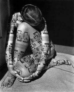 what makes this pic interseting is not so much the woman but the fact that she is wearing DRUM notation. Respect!