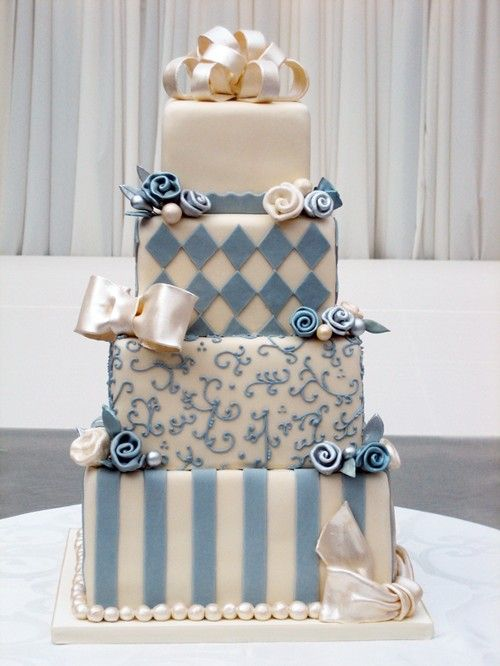 A whimsical French blue wedding cake
