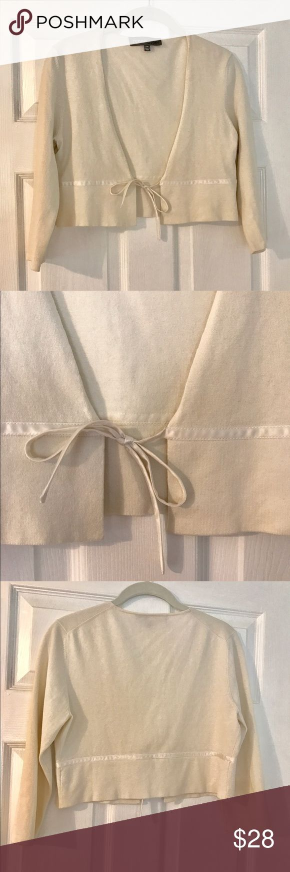 Donna Ricco cropped cream bolero satin ribbon tie Cotton/rayon cream colored bolero with 3/4 sleeves and satin ribbon closure.  Perfect to wear with your summer sleeveless and strapless dresses.  Petite Medium.  Like new. Donna Ricco Sweaters