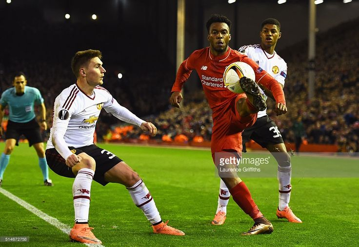 Daniel Sturridge of Liverpool takes on Guillermo Varela (30) and Marcus Rashford of Manchester United (39) during the UEFA Europa League Round of 16 first leg match between Liverpool and Manchester United at Anfield on March 10, 2016 in Liverpool, United Kingdom.