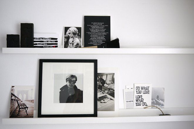 Black and white objects on a white shelf