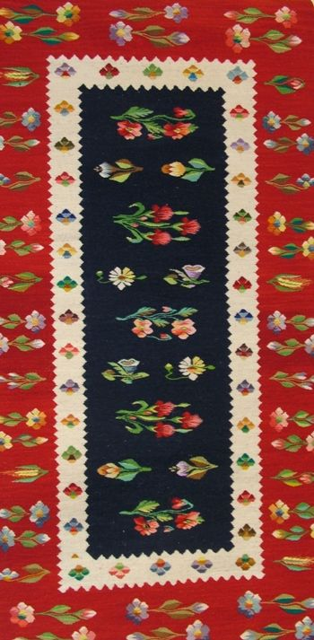 "Romania rug. ""Flowers from the Garden"". Stylized flowers typical of an Oltenia rug. The weaver learned the art of rug making at a monastery in Romania."
