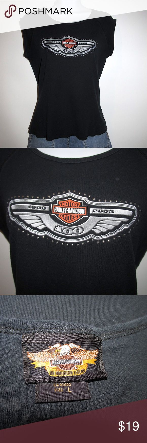 "Harley Davidson Motorcycles Studded T-Shirt EUC Fantastic Harley Davidson Motorcycles studded t-shirt top, ladies size Large.  Scoop neckline  Front studded logo design  Measurements  Length shoulder to hem: 22""  Width across front at underarm: 18""  Sleeve length: 2""  Fabric: 100% cotton  Garment care: Machine wash cold inside out, tumble dry low  From a smoke and pet free home Harley-Davidson Tops Tees - Short Sleeve"