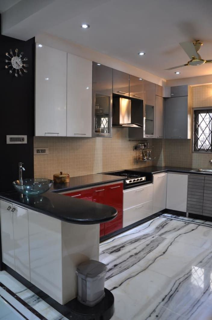 U shaped kitchen with modern cabinets and