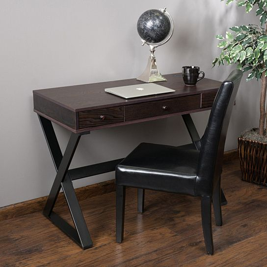 Enjoy the modern feel of the Geena Writing Desk. This desk is a manageable size and will complement any existing decor. This sleek design is constructed with dark stained wood and black steel crossed-legs. The desk also features 3 drawers and an installed desk grommet for cables to further your organizational needs. Perfect for any office space in your home, the Geena writing desk will offer you style and excellent space to organize all of your work and study needs.Features:Constructed with…
