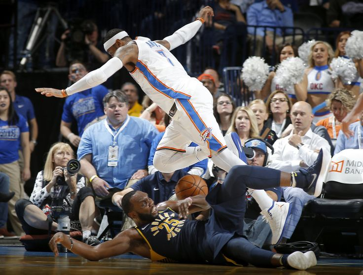 Oklahoma City's Carmelo Anthony (7) leaps over Indiana's Al Jefferson (25) as he goes or the ball during an NBA basketball game between the Oklahoma City Thunder and the Indiana Pacers at Chesapeake Energy Arena in Oklahoma City, Wednesday, Oct. 25, 2017. The Thunder won 114-96. Photo by Bryan Terry, The Oklahoman
