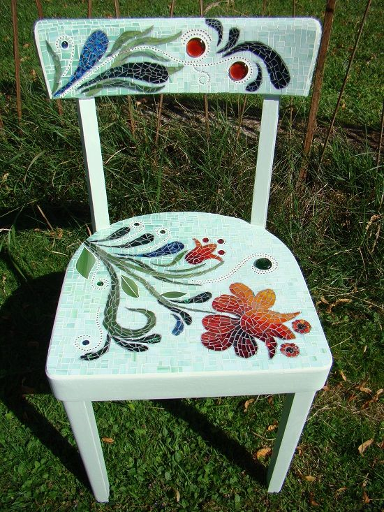 Old chair covered with glass peaces