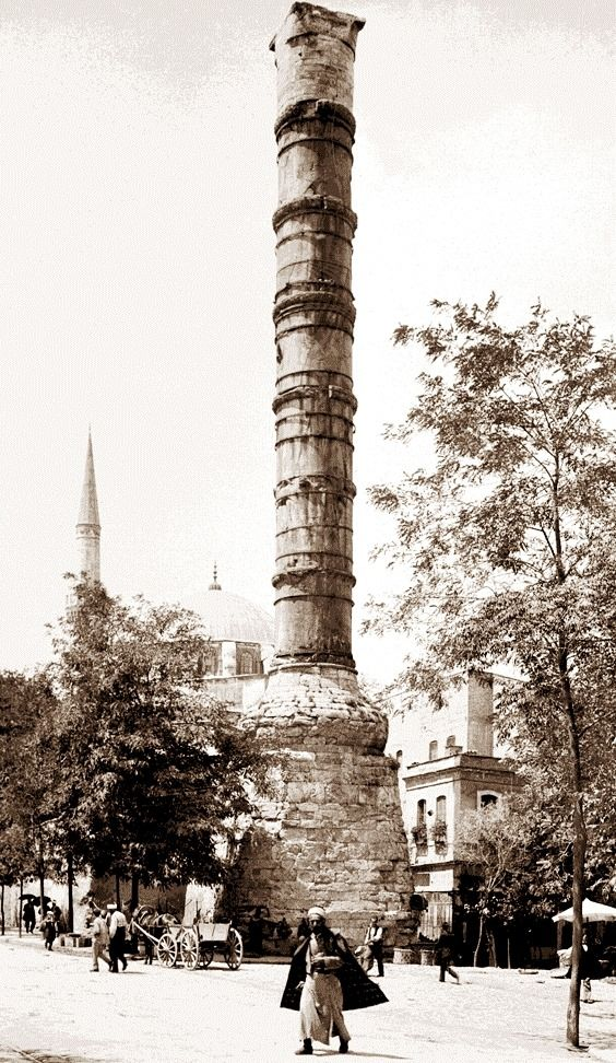 "The view of Cemberlitas (Constantine's Column) in 1880/s, Istanbul. It was first built in Rome at 328 AD., by Roman Emperor Constantine the 1st. Then had brought the column pieces by ships through the seaway to Constantinopolis (later Istanbul) and was erected in its place now. According to the beliefs, some sacred relics from different religions were buried into the ground pedestal of the column. One of them was the chalice of ""Jesus"" in the ""Last Supper"" that, he had his last wine."