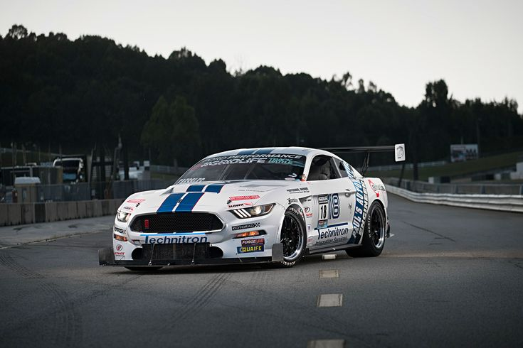 Brian Faessler's wild ride started as a base V6 2015 #Ford #Mustang that was chopped up, equipped with a custom cage, fitted with a #GT350R body, and turned into a one-of-a-kind racing machine. It's powered by a 900rwhp turbocharged 5.0L Coyote and rides on a custom #PaulsAutomotive suspension, Brembo brakes, Hoosier tires, and 18x12/18x13 #Forgeline #GA3R wheels finished with Satin Black centers, Polished outers, and exposed titanium hardware!  Photo by Luke Munnell courtesy of Mustang360.