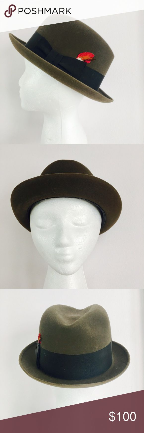 Vintage 1960s Dobbs Fifth Avenue Men's Fedora Hat Vintage 1960s handsome mens fedora style hat from Dobbs of Fifth Avenue.  Will come with the original Dobbs decorative/protective hat box.  Rich dark brown felt material with a darker brown ribbon band with small red feather.  Has been worn, but is in excellent condition.  💸Always open to reasonable offers - PLEASE MAKE THEM WITH THE OFFER BUTTON 😊  ❔ Always happy to answer any and all questions   🚫 Sorry! No trades   🛍 Bundle to save…