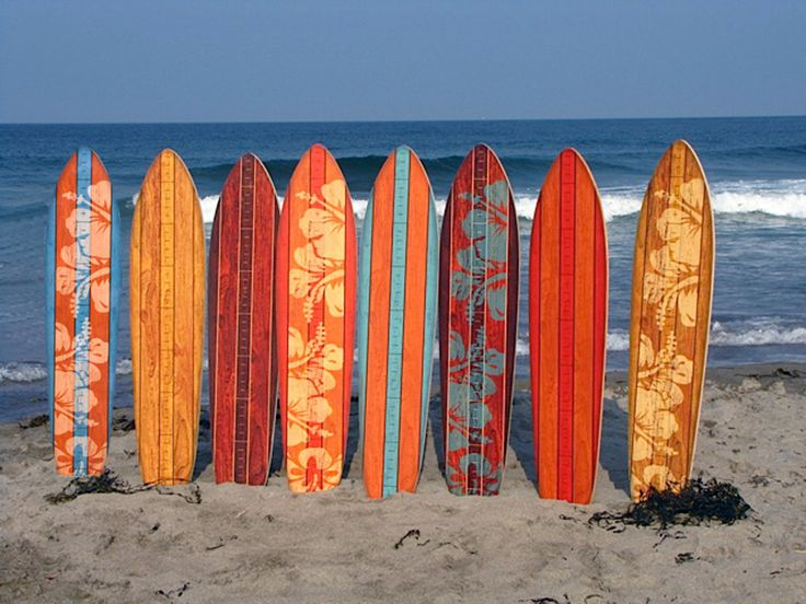These clever vintage wooden surfboards are height growth charts for kids.