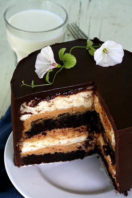 I was looking for angel food cake recipes when I found this instead - Heaven and Hell 2: Alternating layers of devil's food cake, angel food cake and peanut butter mousse covered in rich chocolate ganache.