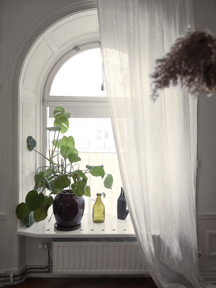 Beautiful windows in apartment in an old milk shop for sale in Stockholm.