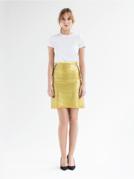 Mira- Made from embroidered fabric from Jakob Schlaepfer with matte sequins, the short shirt's A-line shape is both elegant and flirty. The skirt features a unique embroidery technique which keeps the sequins securely attached. Swiss made