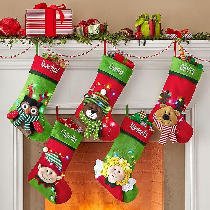 """These Christmas stockings are the definition of """"Merry & Bright."""" Make your mantel happy this holiday season with festive Christmas stockings like these LED Tangled in Lights Stockings!"""