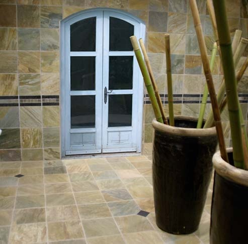 #Sandstone #tiles add natural beauty to this #courtyard area accentuated by large pots with bamboo stems. #UnionTiles