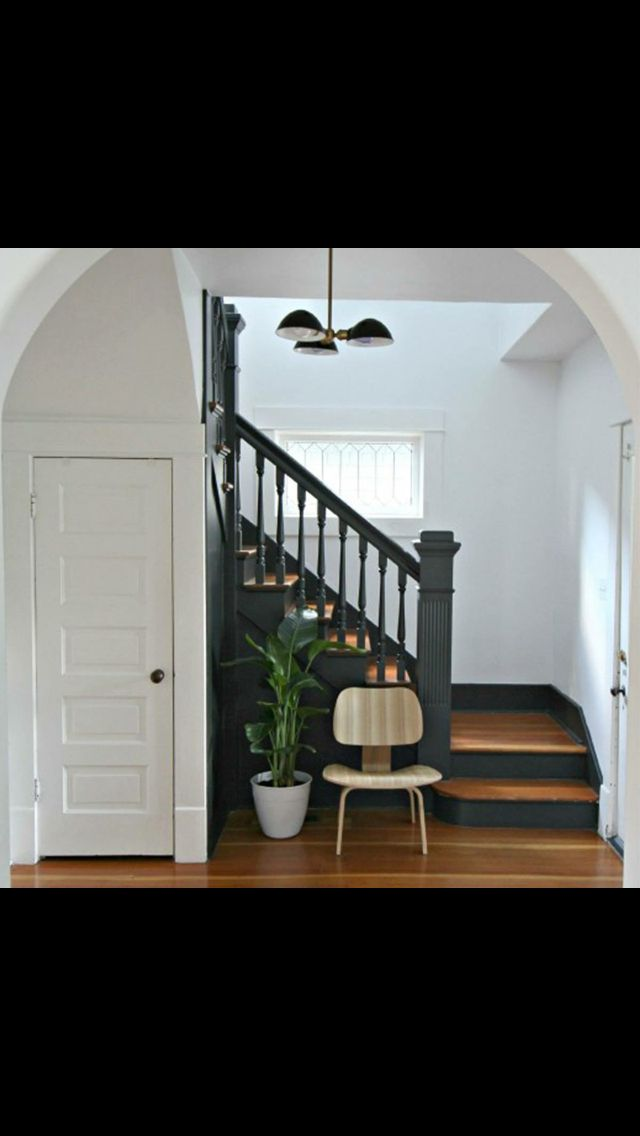 Love this look of dark railings and kick plate on the stairs