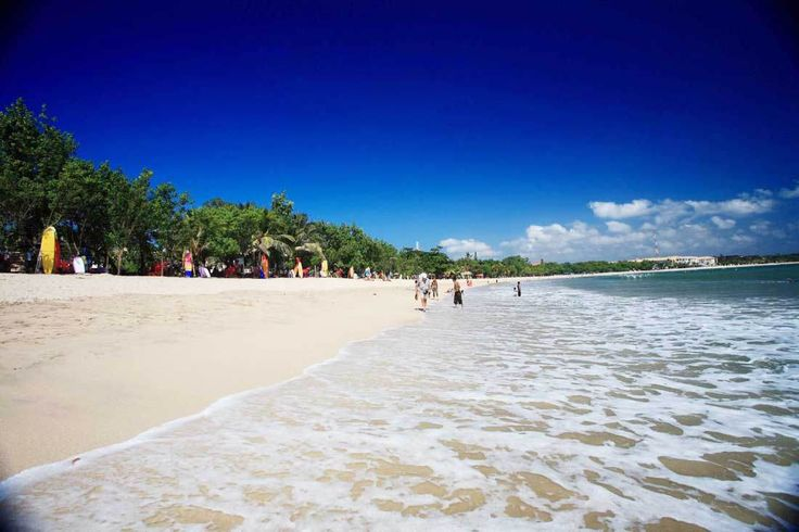 Kuta white sandy Beach, The most famous destination object in Bali  island, Legendary Kuta Beach, the center of nightlife in Bali, exactly in 61 Legian street, find the new world here at the midnight.