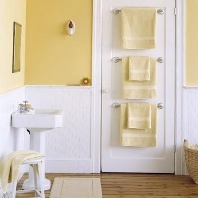 20 ways to make a small bathroom big- Towel Racks   Attaching multiple towel racks to the inside of a bathroom door will save space. This look can be accomplished by buying multiples in any good quality towel rack, like the polished chrome Delta Silverton towel rack. At Home Depot; $27.48.