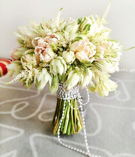 Protea bouquet.  Love the beaded wrap!