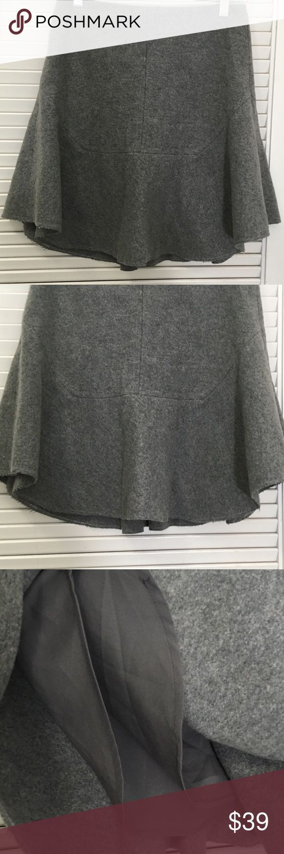 "Madewell Wool Blend Skirt A-Line Gray Madewell Atelier Skirt Grey.  A structured wool A-line skirt with a subtle ruffle at the hem—it can go day to night, no problem.   Back zip.  Dry clean. Import. Beautiful Madewell women's Skirt.  Color is Heather Gray. Material is 80% Wool with a 20% nylon Blend.  Trumpet godet A-line style. Fray at the bottom is part of the design. Career Casual Modest Size 0.  Measurements: 14.5"" waist, 17.75"" length Madewell Skirts A-Line or Full"