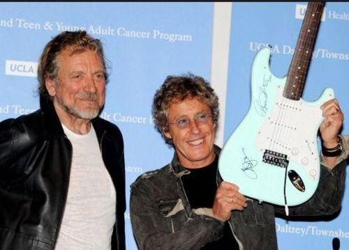 Robert Plant and Roger Daltrey in L.A. for the UCLA Cancer Charity for Adults and Children--autographed guitar up for auction. http://www.charityfundraisingexperts.com/