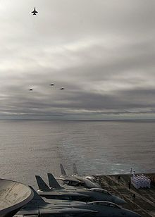 """The missing man formation is an aerial salute performed as part of a flypast of aircraft at a funeral or memorial event, typically in memory of a fallen pilot, a well-known military service member or veteran, or a well-known political figure.[1][2] The formation is often called the """"missing man flyby"""" or """"flypast"""".[3]"""