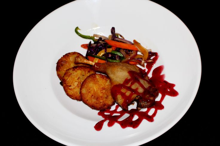 Tomi's Roasted Duck Leg served with Kumara Rosties, Julienne Vegetables and a delicious Spiced Plum Sauce.