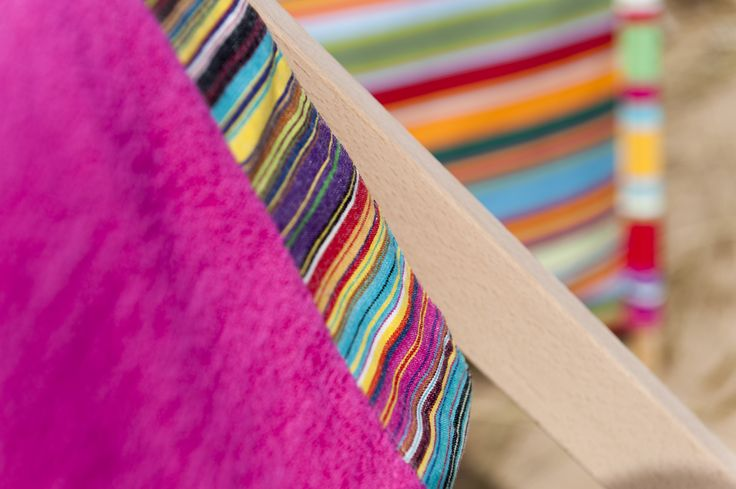 Bright pink extra large beach towel in bright multi stripe fabric