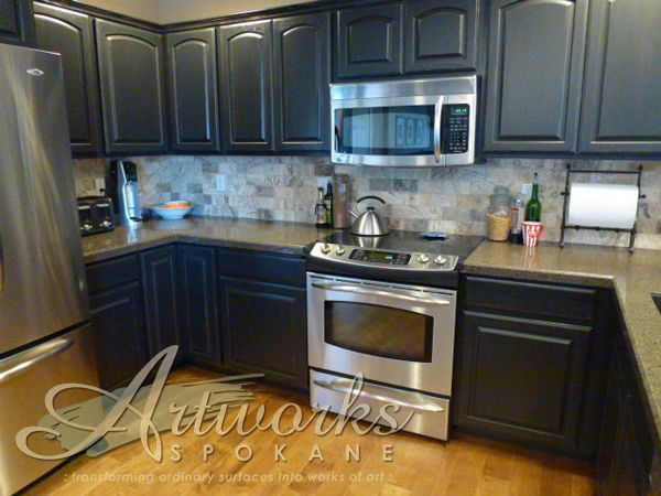 Oak cabinets finished in Graphite Chalk Paint® decorative paint by Annie Sloan. with a light distress. #artworksspokane, #anniesloanunfolded