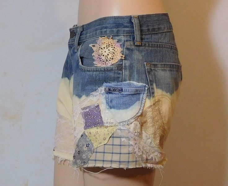 """Mens Levi 559 upcycled jean shorts. Trashed, bleached then repaired with patches of vintage material, lace and an extra pocket on the left side. 100% cotton.  34"""" waist"""
