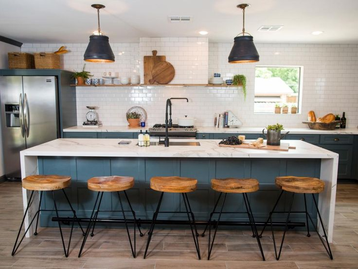 The kitchen is enlarged and remodeled with a simple design and fresh, clean aesthetic.