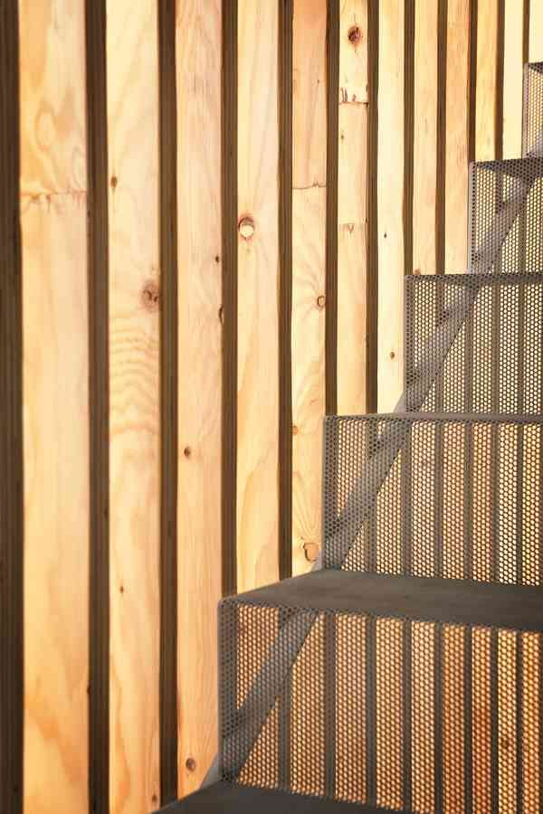 Detail At Stair Wood Slats And Perforated Metal Stair