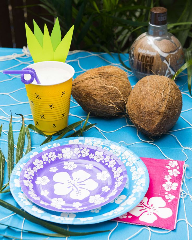 Grab some tropical items from the store and transform your table into a beachy bar space. Why not add some coconuts to play up the summer theme?