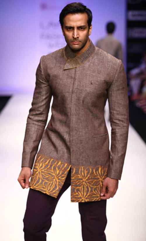 Abhishek Dutta's men's wear set heart rates soaring with an array of tussore jackets with a twig motif embellishment on the hem; linen shirt with cut-work yoke; grey mandarin collar jacket with two low pockets; a bundhgala with an embroidered edge, and the like.
