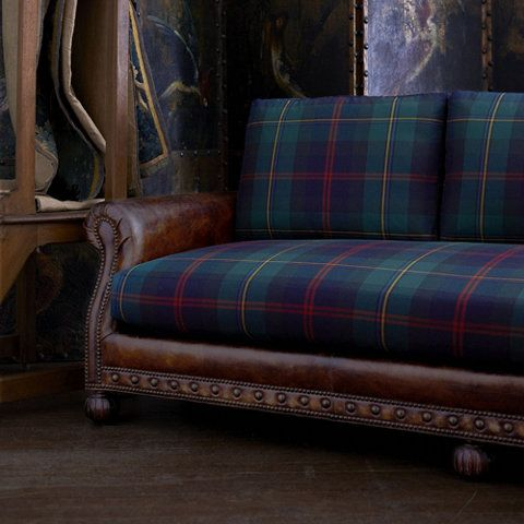 Tartan (Plaid) and Leather sofas are possible the most lovely pieces of furniture on earth! This the Aran Isles Sofa from RalphLaurenHome.com