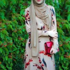 beautiful dress whith a beautiful hijab  and red bag