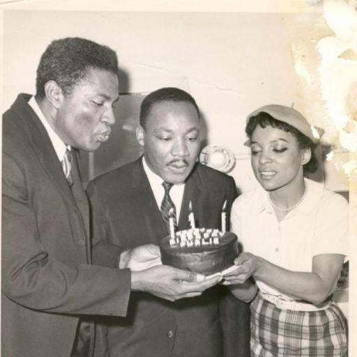Ossie, Ruby, and Dr. Martin Luther King, Jr. share a birthday cake for the 100th performance of Purlie Victorious.