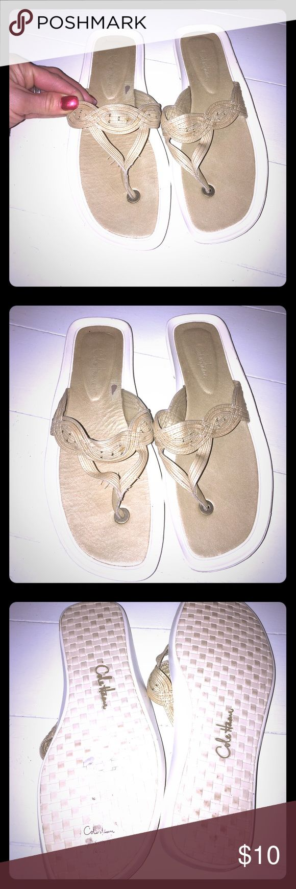 Cole Haan Sandals NWOT Only worn to try on. The straps are a little bent from being stored  but straighten out once u put your foot in. These are white rubber on the bottom with gold braided leather straps. Cole Haan Shoes Sandals