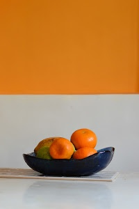 Tangerines by Priyanka Nayar - Tangerines in a fruit bowl.