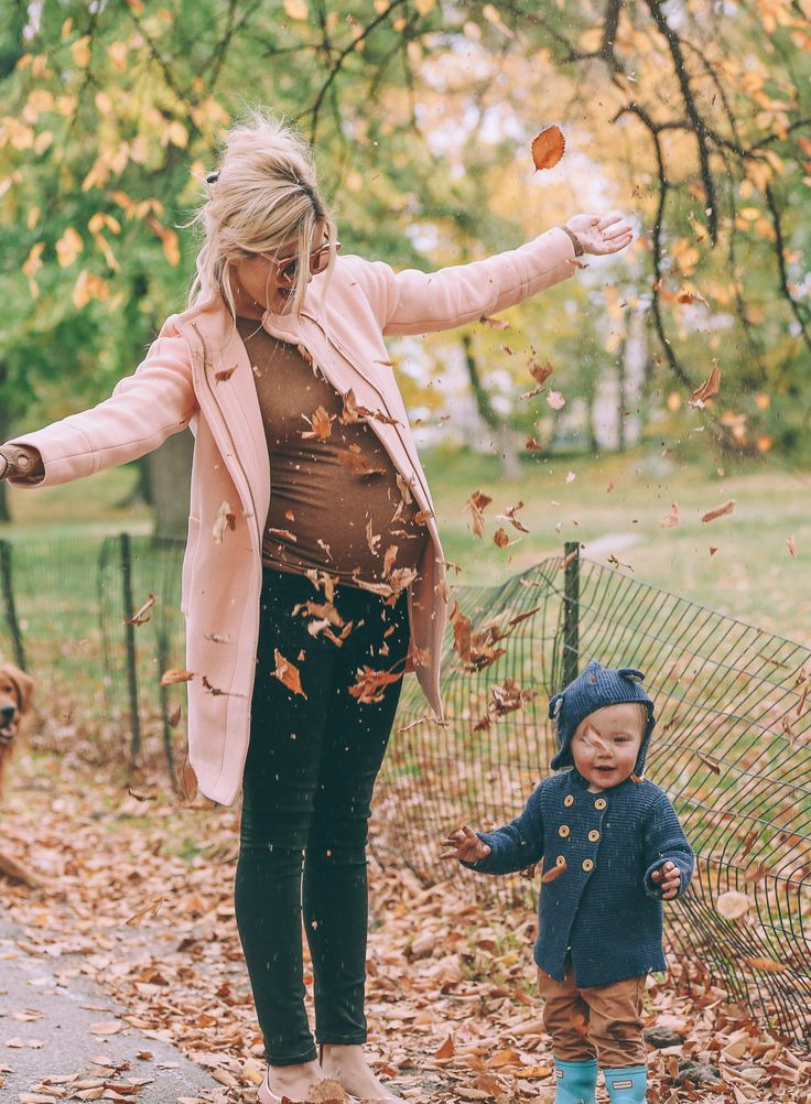 pink coat and skinny jeans barefoot blonde maternity outfit
