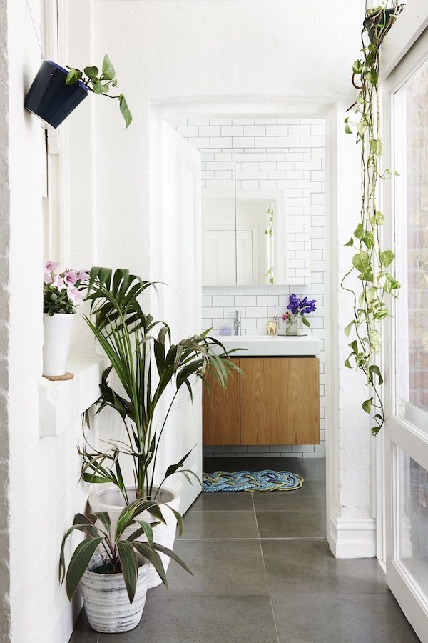 WHite subway tile and plants in the bathroom.  Melbourne Home · Marni Kornhauser and Katherine Laurie via the Design Files