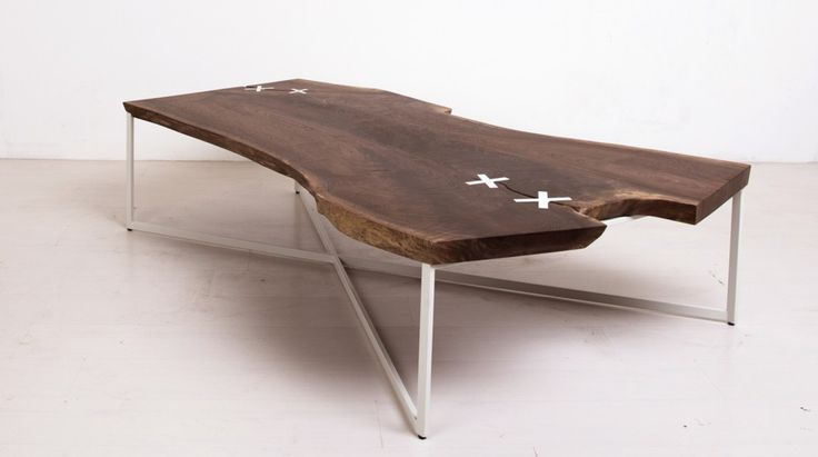 """Shown in claro walnut with powder coat base and reclaimed plastic """"x"""", 60 x 36 x 16H DESCRIPTION The Stitched Table is built around a one-of-a kind, flitch-cut hardwood slab. Split nearly in two by a dramatic and naturally occurring check, the slab is held together and reinforced by four X-shaped """"stitches."""" The stitches (made …"""