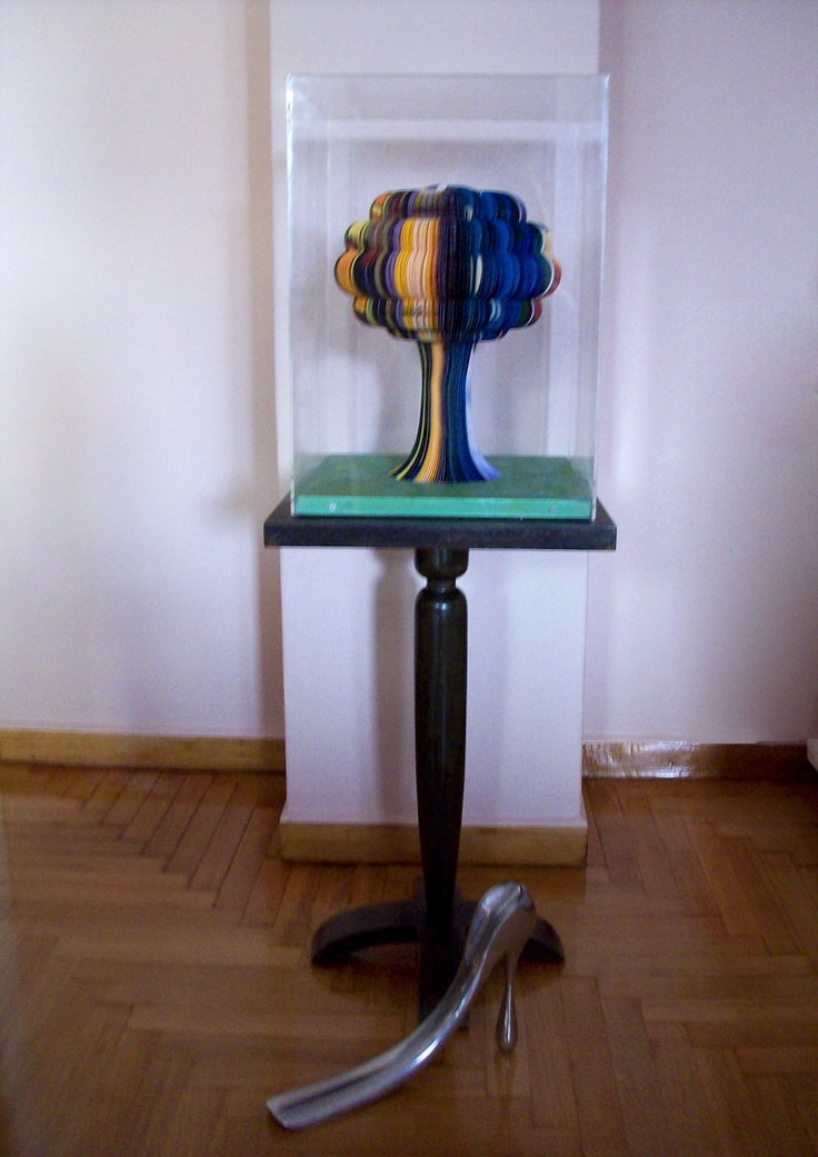An urban apartment in the center of Athens, Greece.  Modern art designed by PAVLOS, on top of an old side-table, combined with modern art designed by MANOLO BLAHNIK.  There is a mix of new & old, topped with color