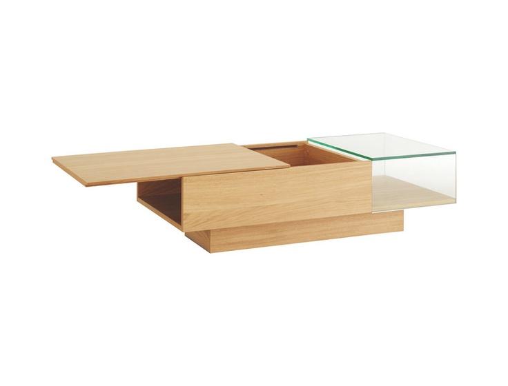 Akira sofabord i glass og lakkert eik. Dimensjoner: L110 x B51 x H31cm. Kr. 3545,-