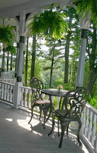 Porch with hanging ferns...love the painted porch posts!