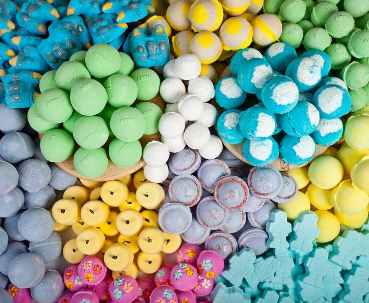 Looking down at huge pile of colourful Lush bath bombs