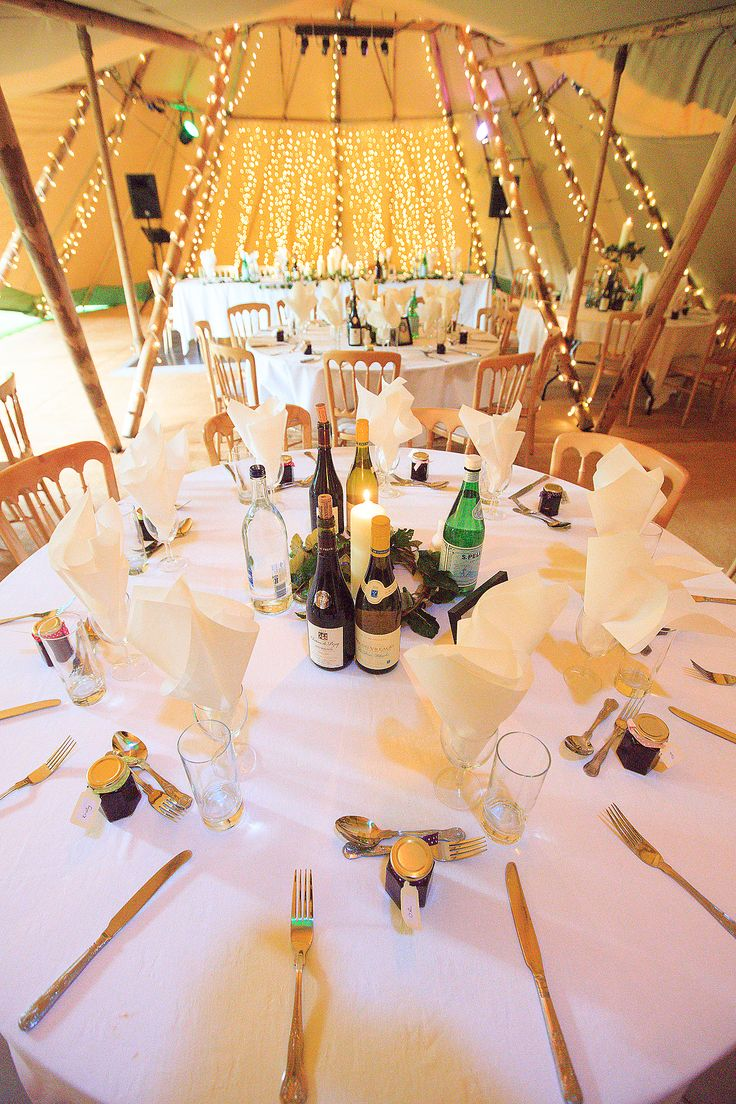 A very elegant and formal wedding breakfast decor. With crisp white linen and gold chivari banqueting chairs. The fairy lights add that little sparkle of magic.